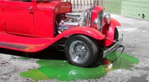 an old car leaking antifreeze