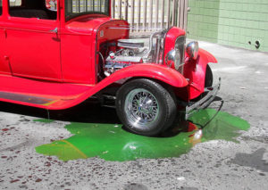 an old car leaking its coolant