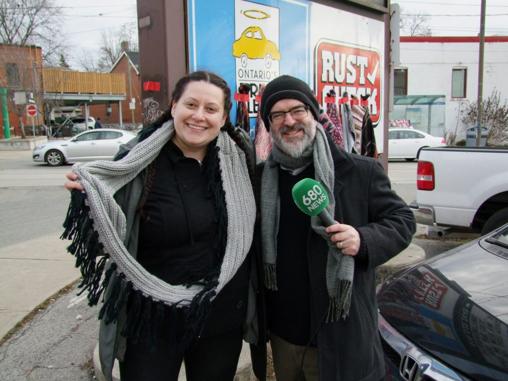 Josie from High Park Master Mechanic meeting with a newscaster from 680 news