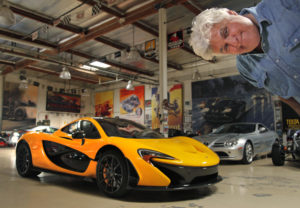 celebrity mechanics jay leno in his garage posing with a yellow Lamborghini from his auto mechanic show