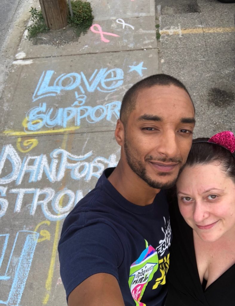 Josie poses with artist in front of #TorontoStrong artwork