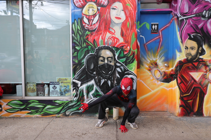 Spidey poses in front of Master Mechanic High Park before doing the #inmyfeelings challenge.