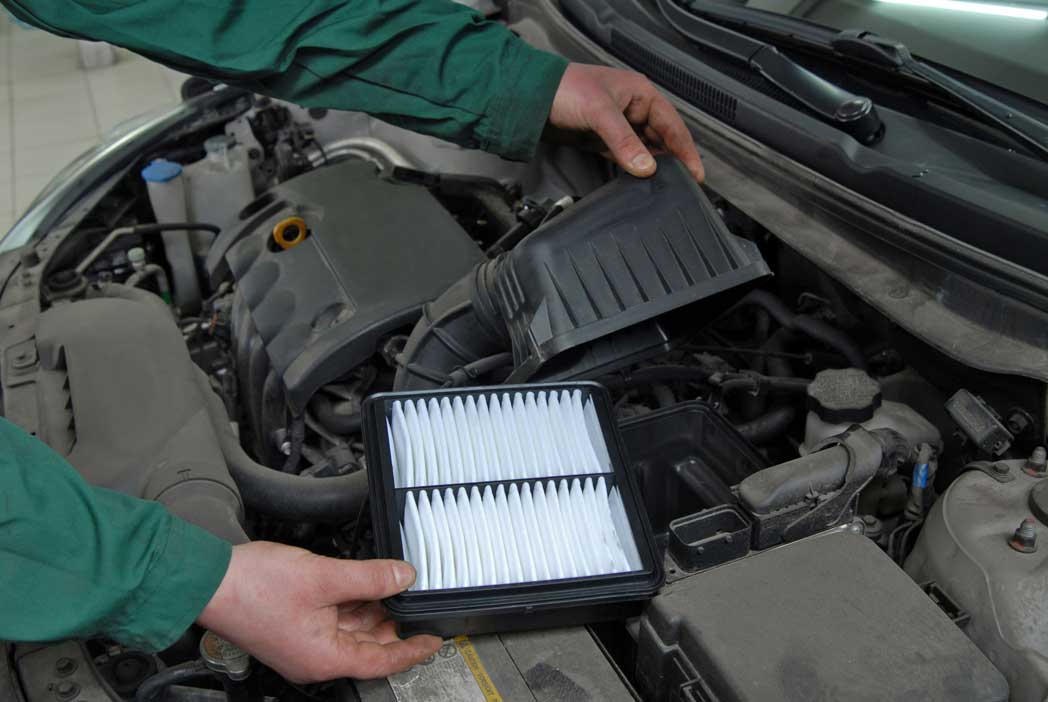 air filter being installed in vehicle