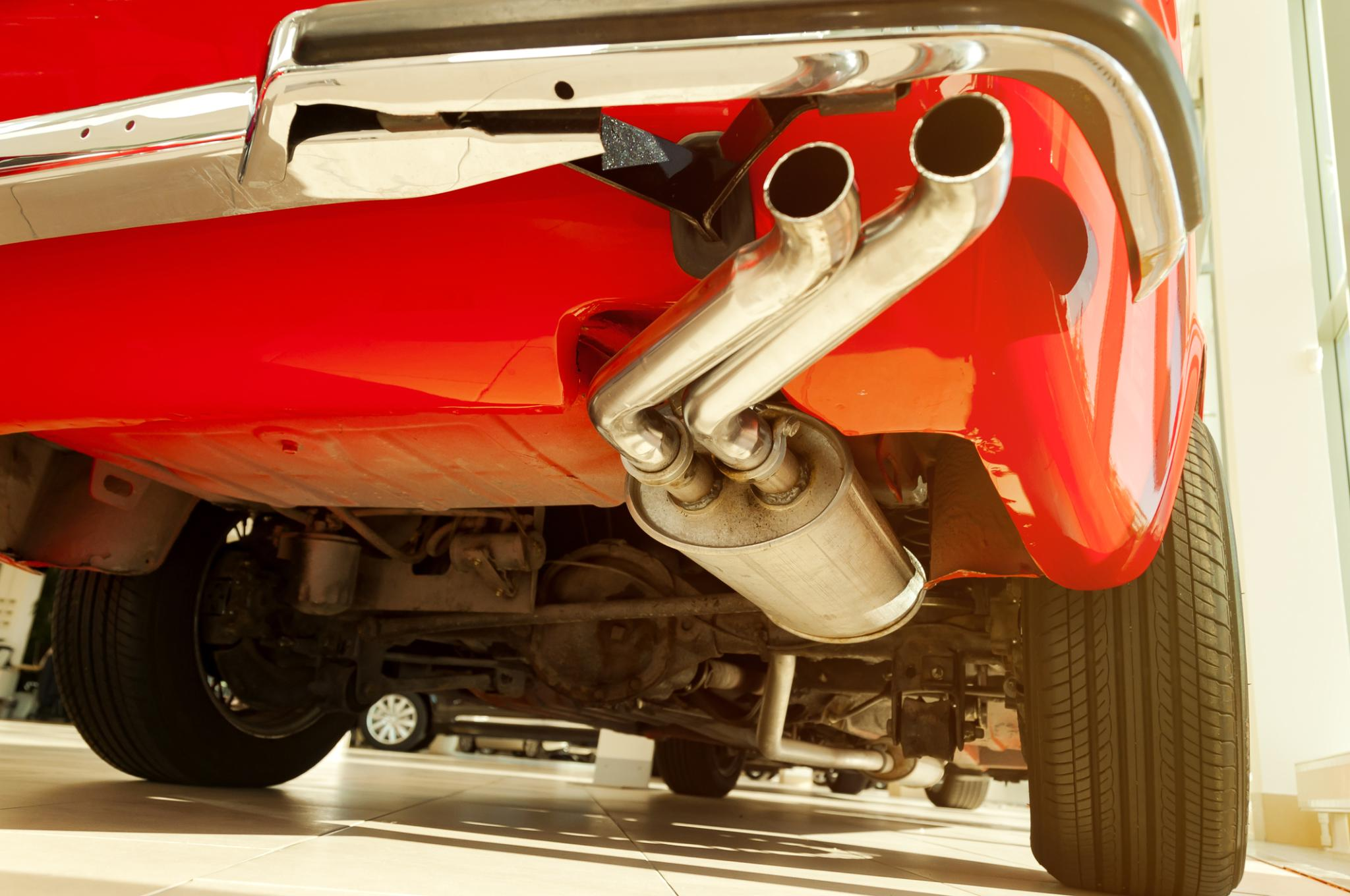 muffler repair on red sports vehicle